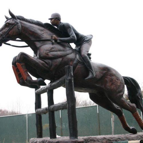 Huntsman on Horse Jumping Fence