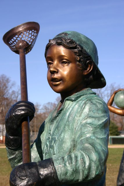 Boy Playing Lacrosse