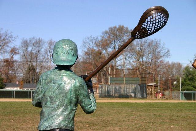 Boy Playing Lacrosse
