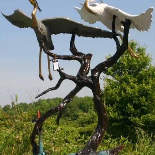 2 Flying Herons