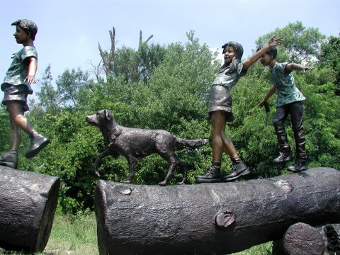 Three Children Walking on Logs with Dog