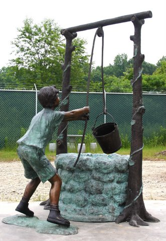 Boy Drawing Water From Well